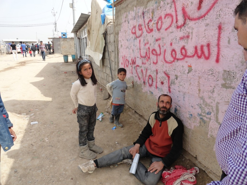 A Syrian father and his kids living on the streets of the refugee camp.
