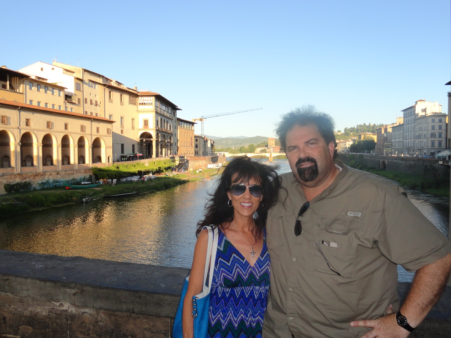 At the Ponte Vecchio bridge in Florence.  Yes, it was windy!  :)