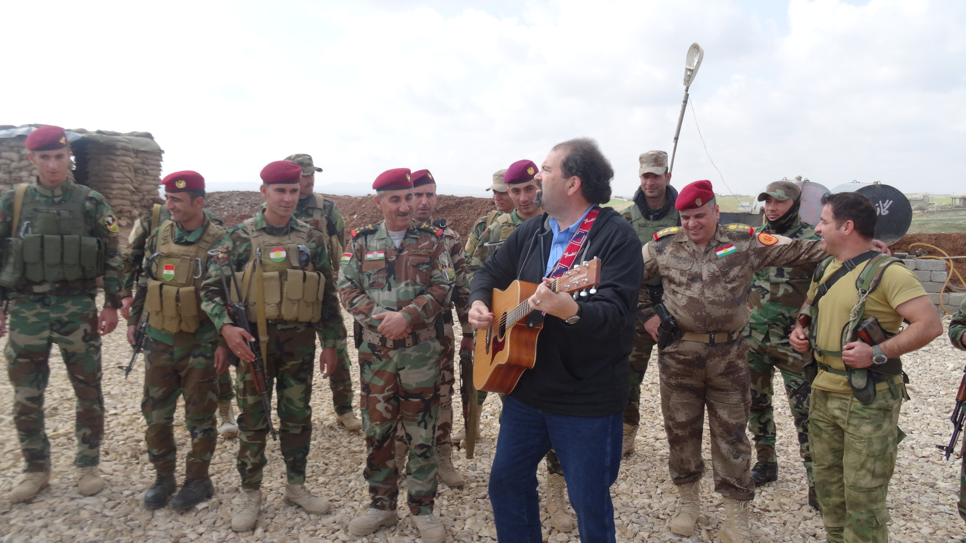 Randy entertains some members of the Pashmerga (Kurdish) army at the border