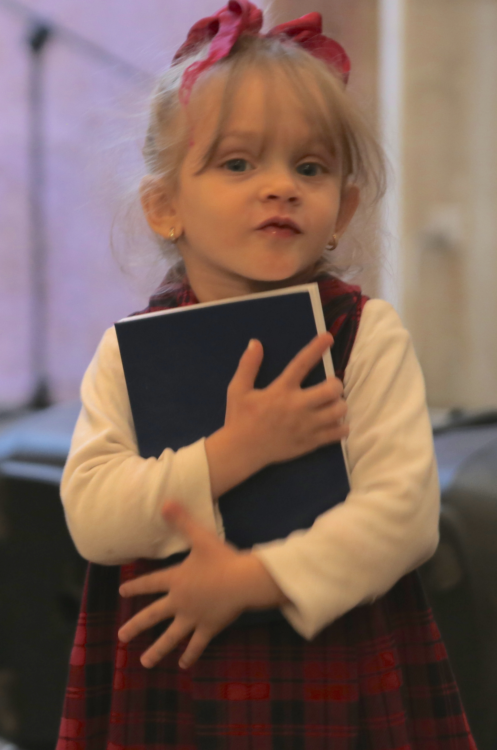 Young girl with new Bible